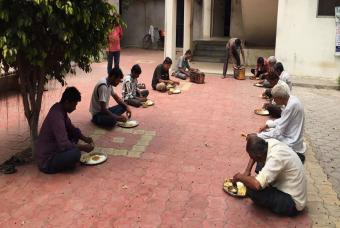 People sit down for a meal