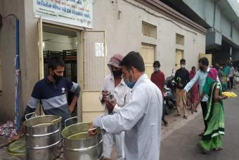 Volunteers help distribute the food