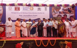 Anandiben Patel and dignitaries on stage at Surat kitchen inauguration